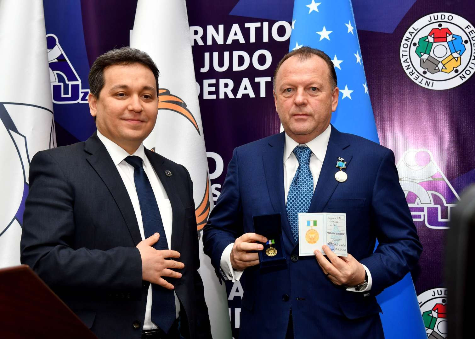 IJF President Marius Vizer, right, was awarded the Award of Sponsor of Education by Uzbekistan's Education Minister Sherzod Shermatov after announcing an expansion of the