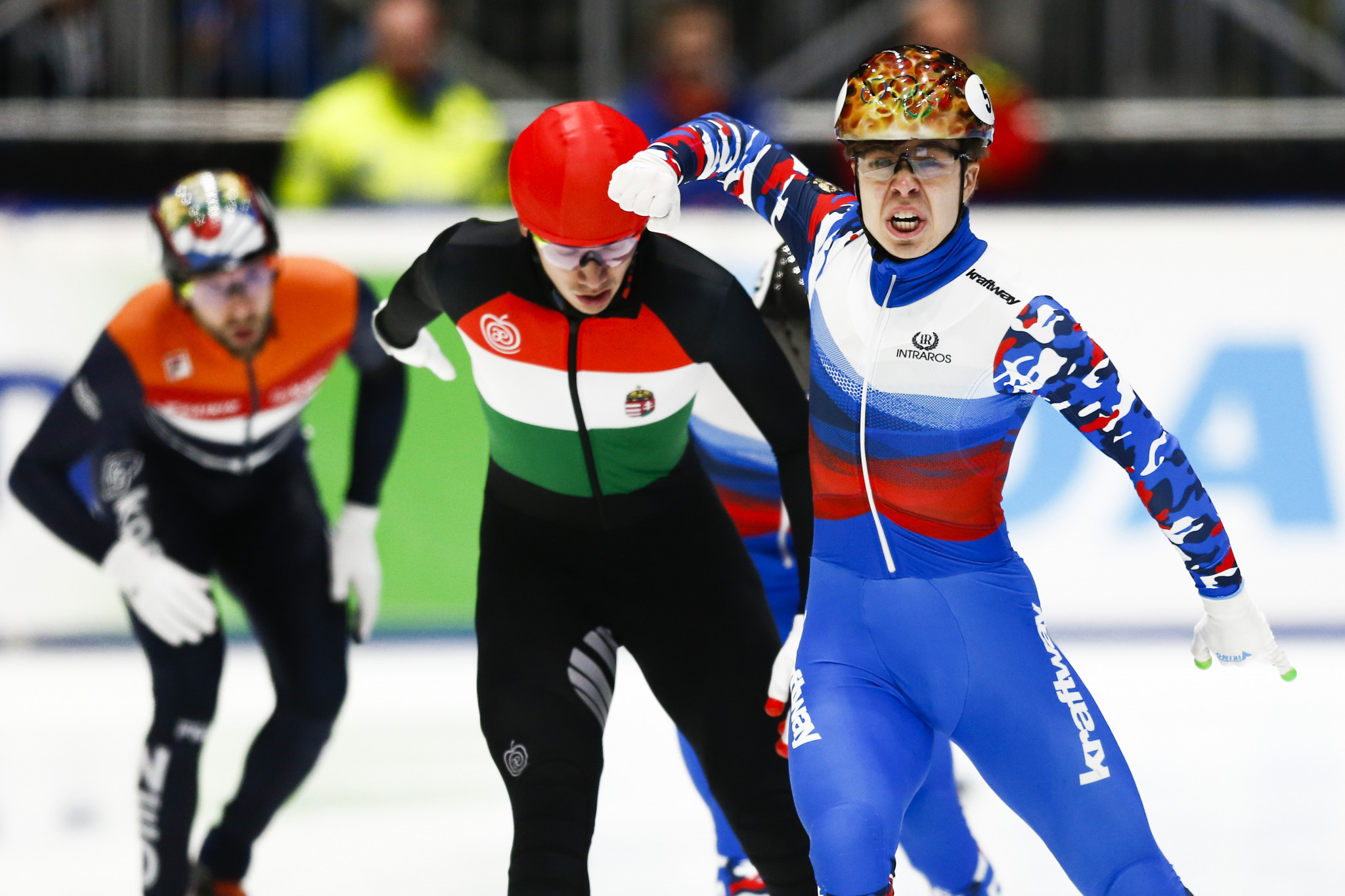 Semen Elistratov, right, of Russia celebrates winning the 1,000m final before Shaolin Sandor Liu of Hungary at the ISU European Short Track Speed Skating Championships in Dordrecht, 2019. ©Getty Images