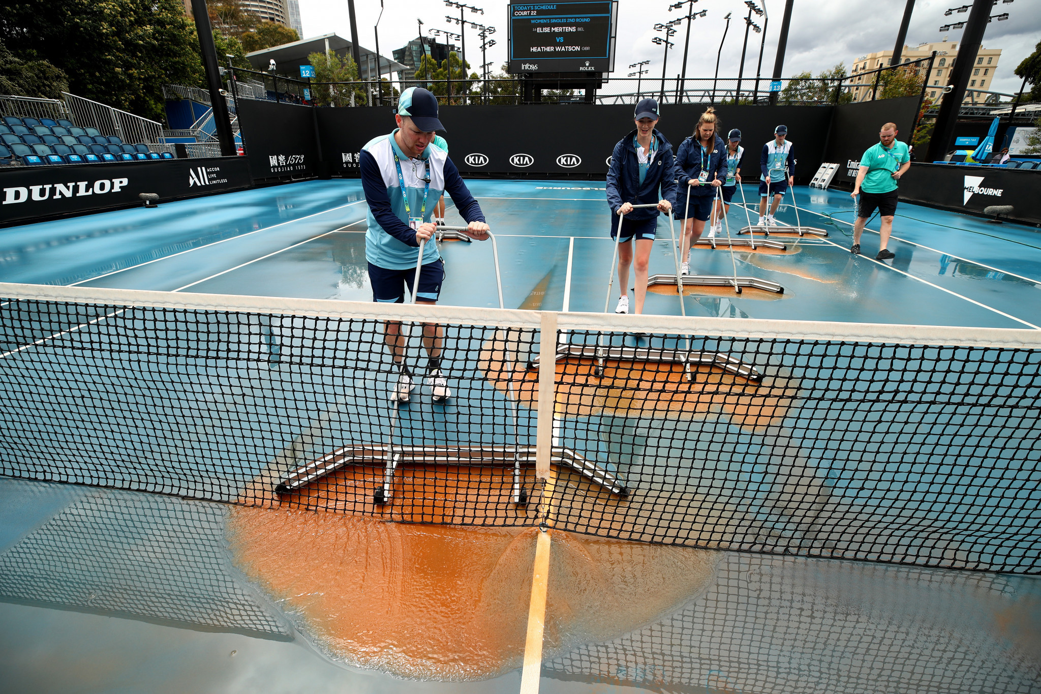 Heavy rainfall deposited dust on day four of the Australian Open, delaying play on the outside courts ©Getty Images