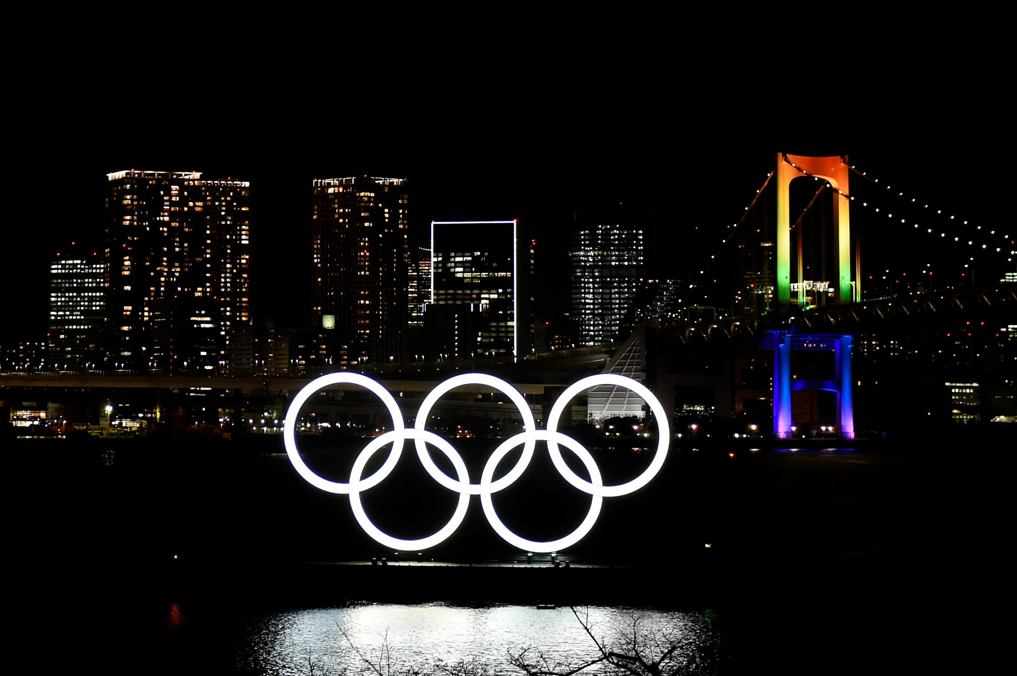 Tokyo marks six months to Olympic Games with fireworks and rings monument lighting