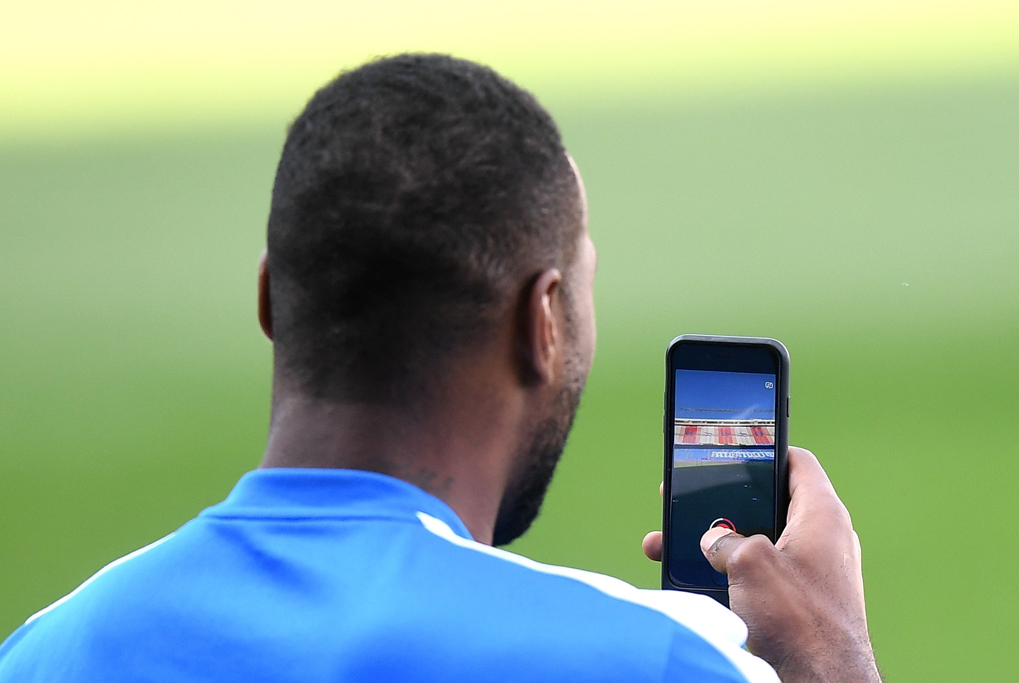 Leicester City captain Wes Morgan uses Snapchat during a training session ©Getty Images