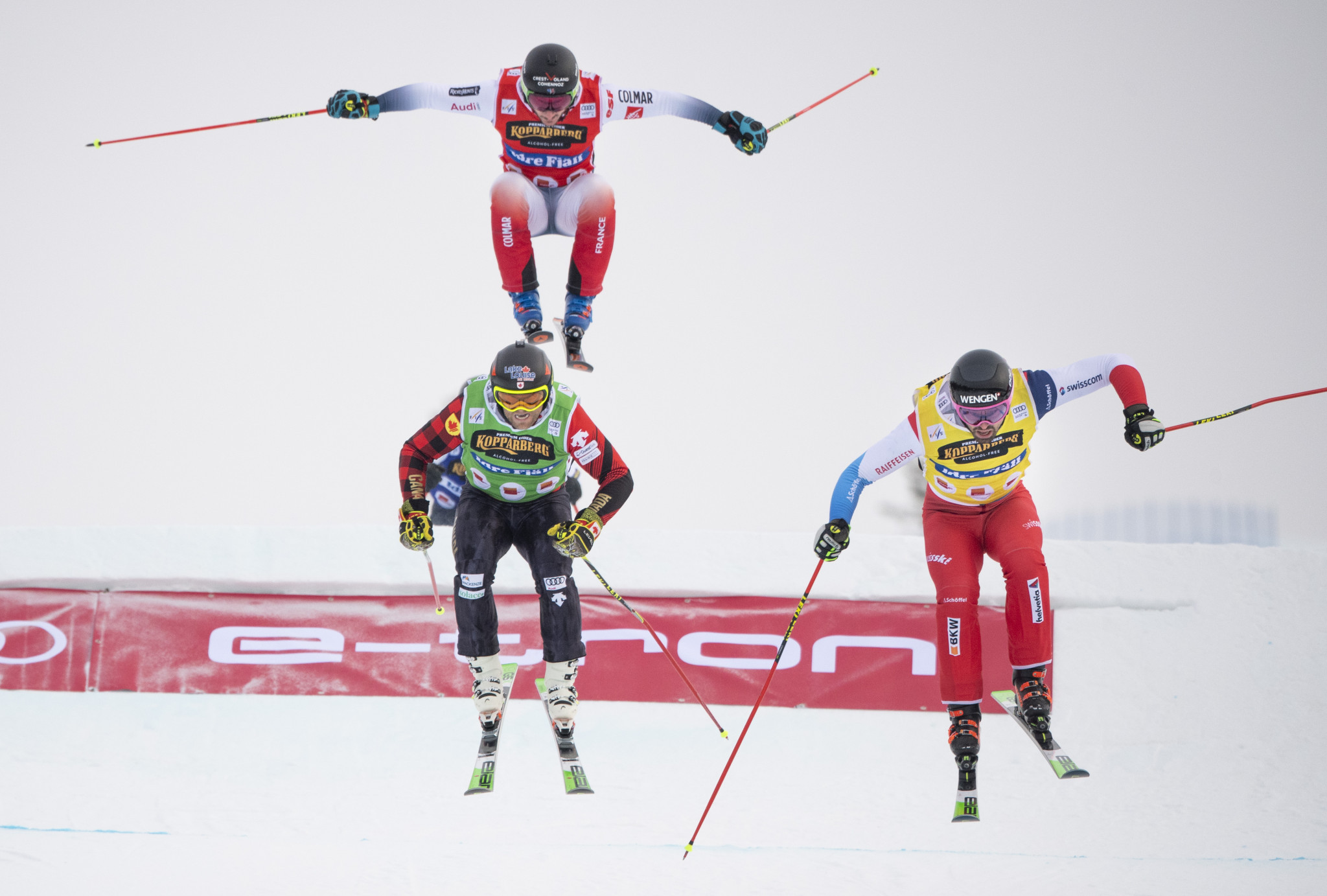 Ryan Regez of Switzerland, yellow, overtakes Brady Leman of Canada, green, in the final jump ©Getty Images