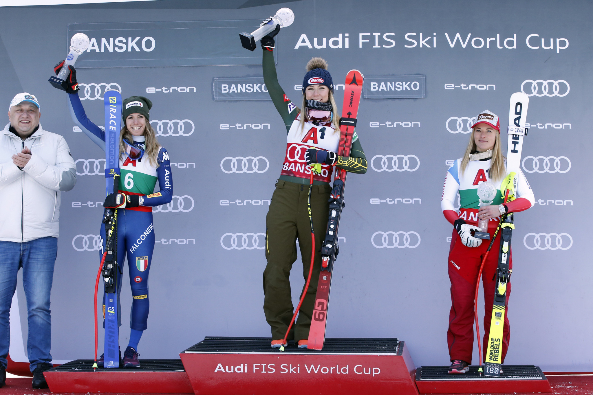 Mikaela Shiffrin, centre, takes her place on the podium ©Getty Images