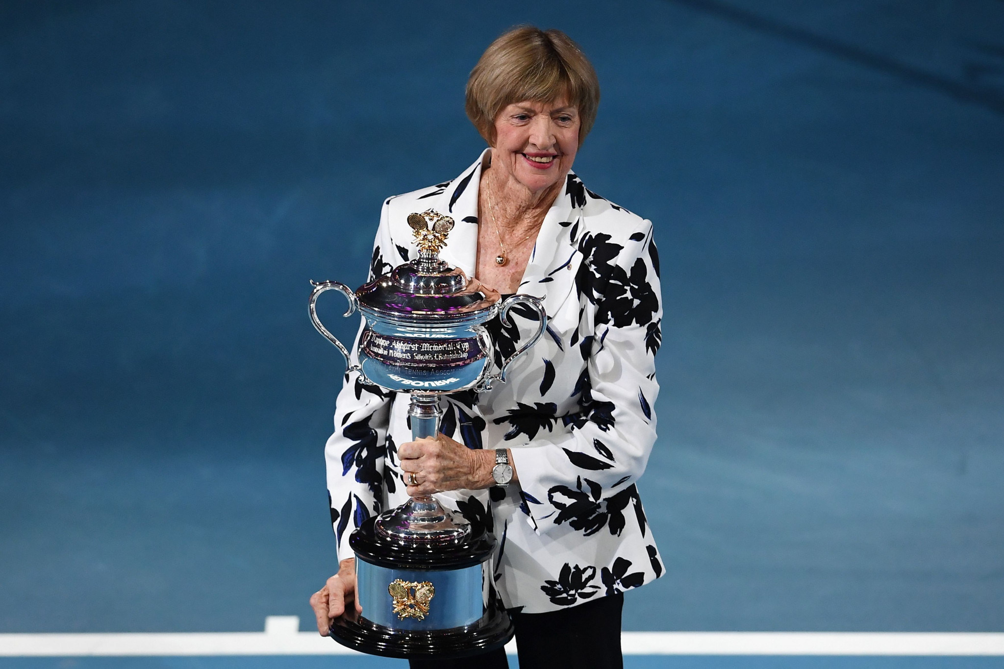Controversial tennis champion Court presented with trophy at Australian Open