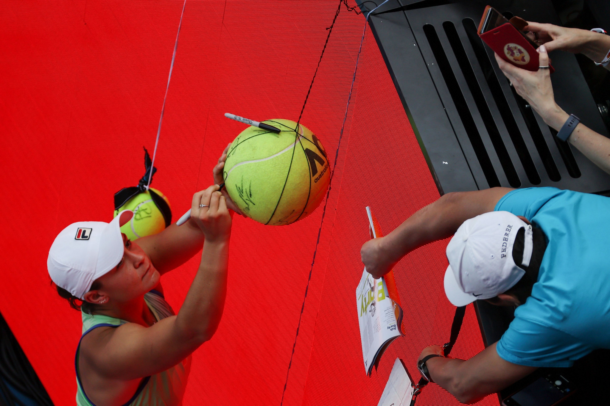 Barty signs a giant tennis ball after reaching the semi-finals ©Getty Images