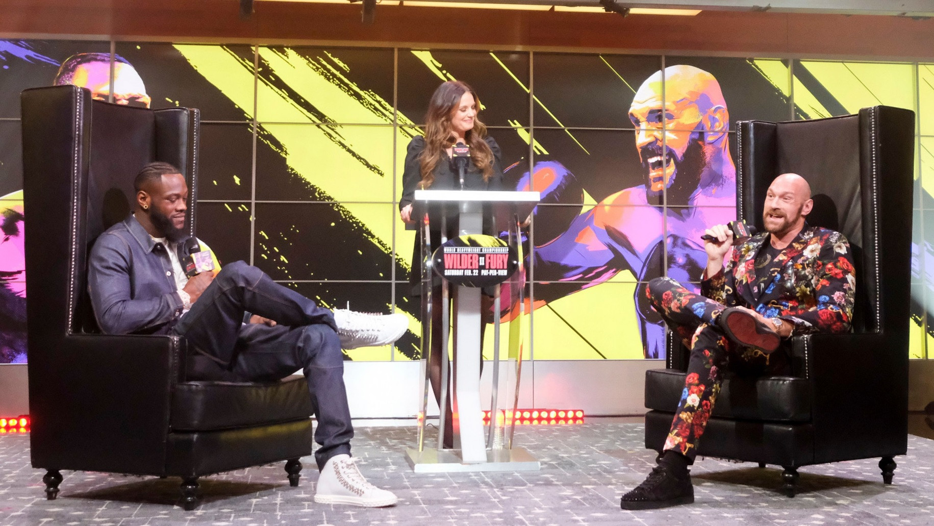 Deontay Wilder and Tyson Fury go head-to-head at a TV event ahead of their heavyweight fight earlier this year - ©AFP
