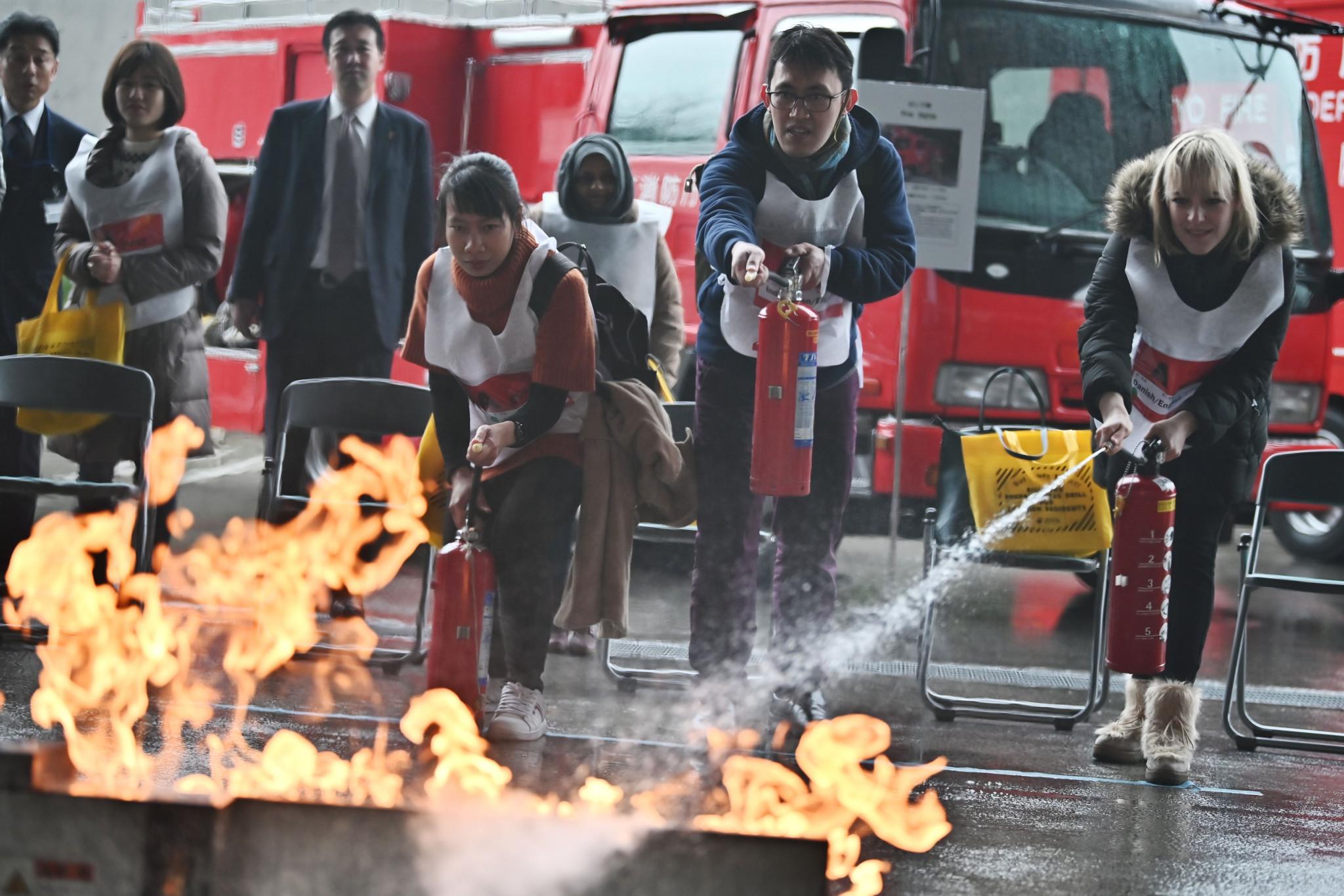 Tokyo 2020 run drills preparing visitors for natural disasters