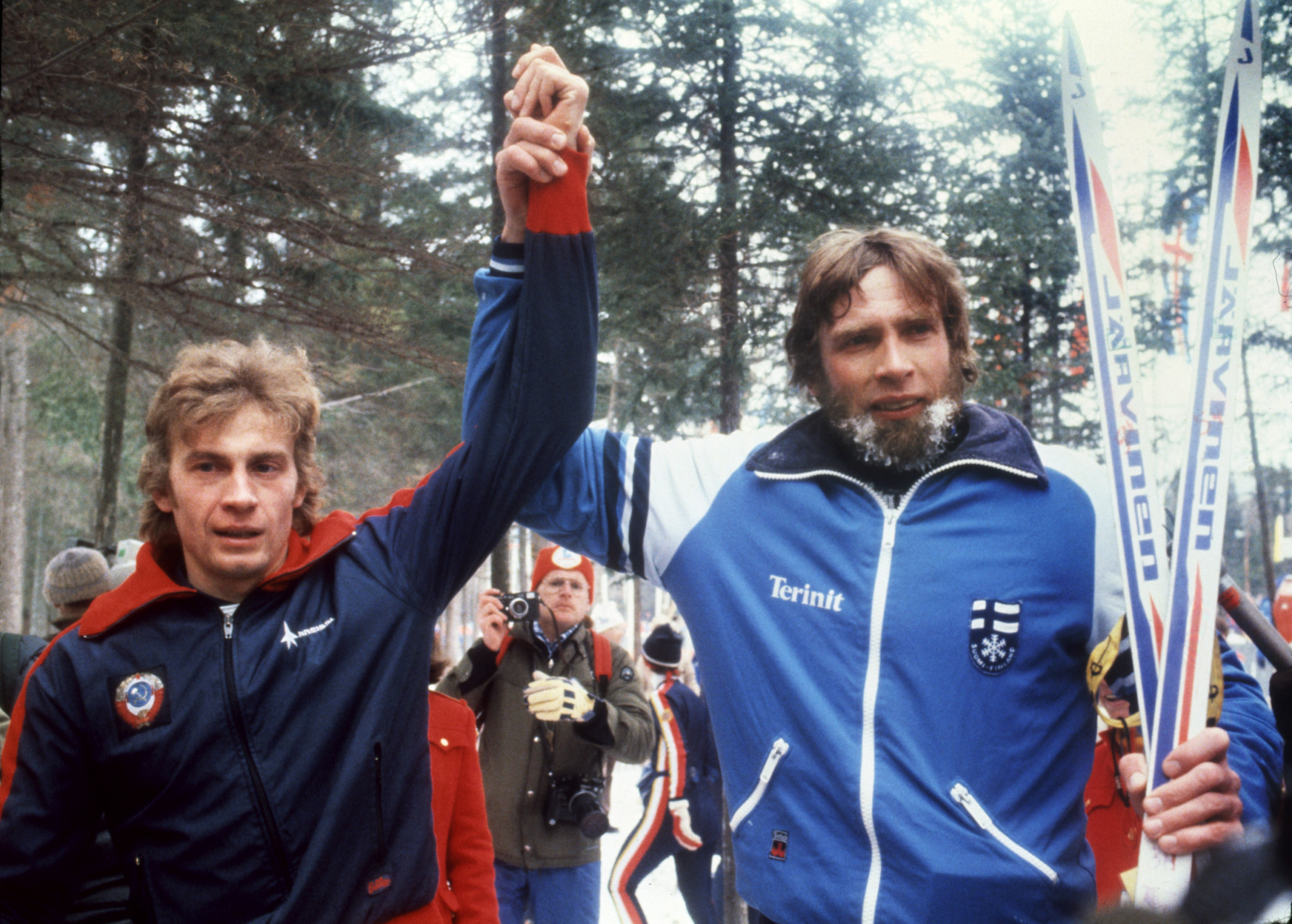 The Soviet Union's Nikolai Zimyatov, left, has his arm raised by silver medallist Juha Mieto of Finland after winning one of his three gold medals ©Getty Images