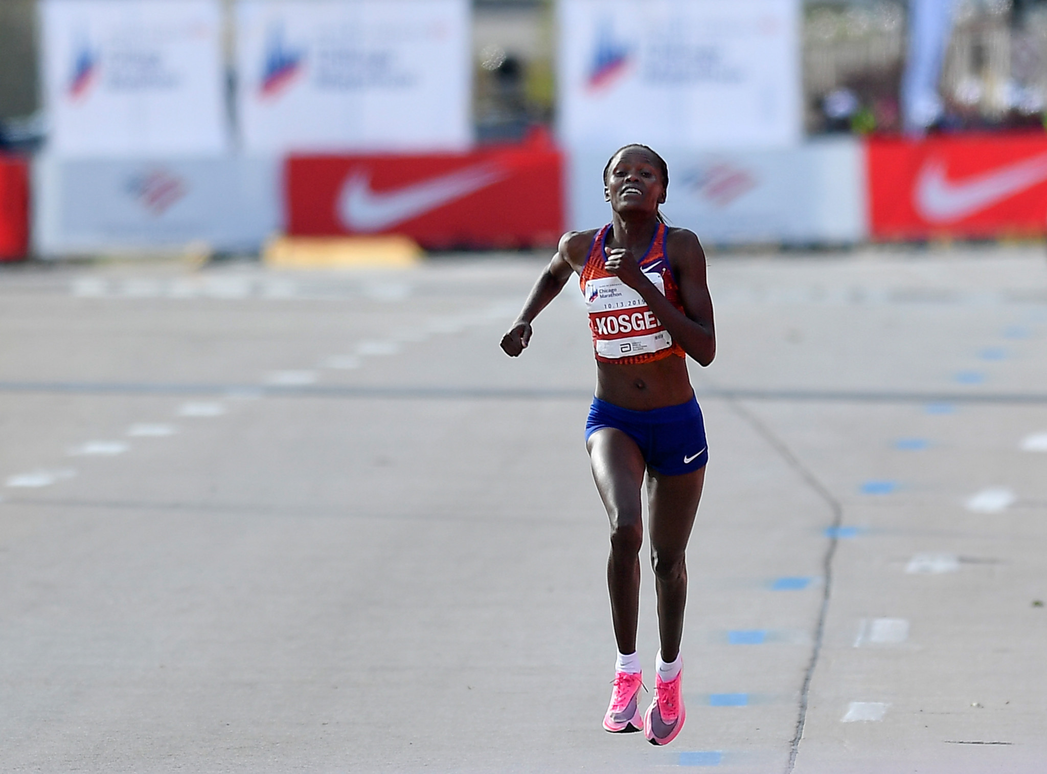 Eliud Kipchoge's countrywoman Brigid Kosgei wore the same Nike model of a shoe in Chicago the day after he ran a sub-two hour marathon to break Paula Radcliffe's 16-year-old world record ©Getty Images