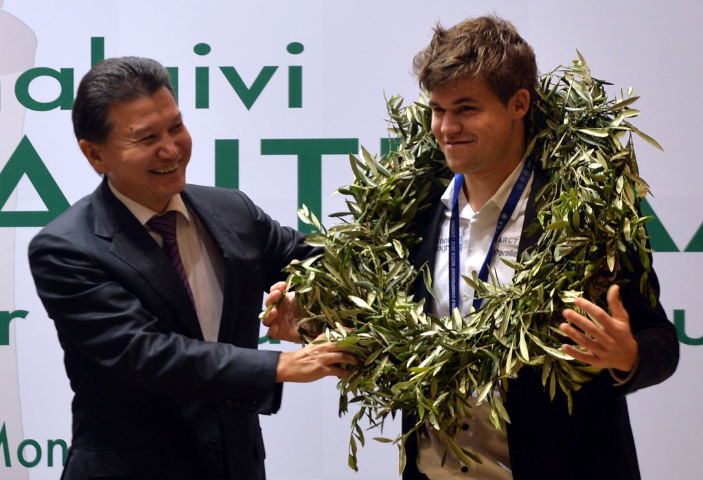 Under Kirsan Ilyumzhinov, seen here crowning new world champion, Norway's Magnus Carlsen in 2012, has become an IOC-recognised sport and is a member of the Association of ARISF ©Getty Images