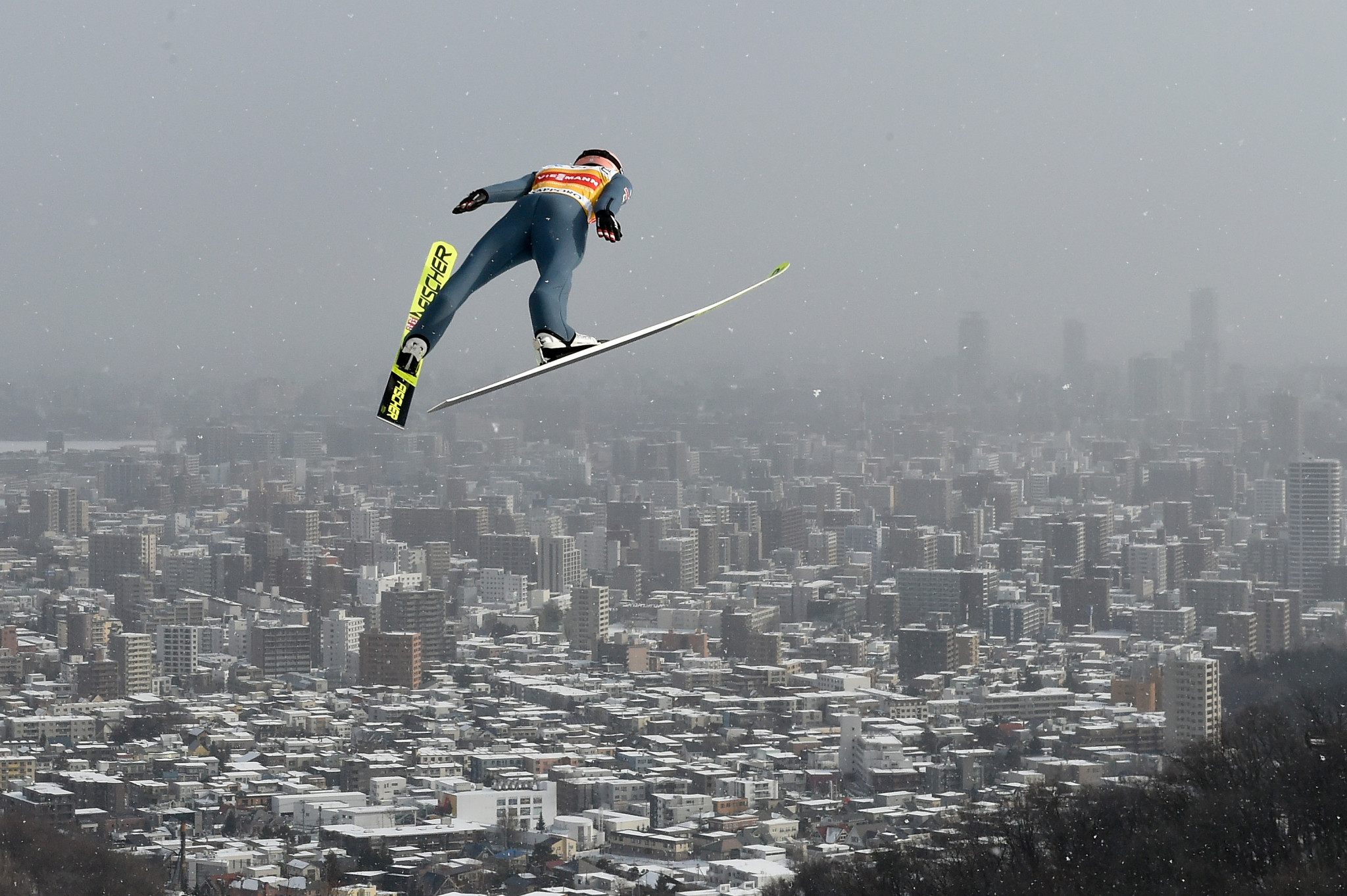 Stefan Kraft won last time out in Sapporo, he is pictured here jumping out towards the city ©Getty Images