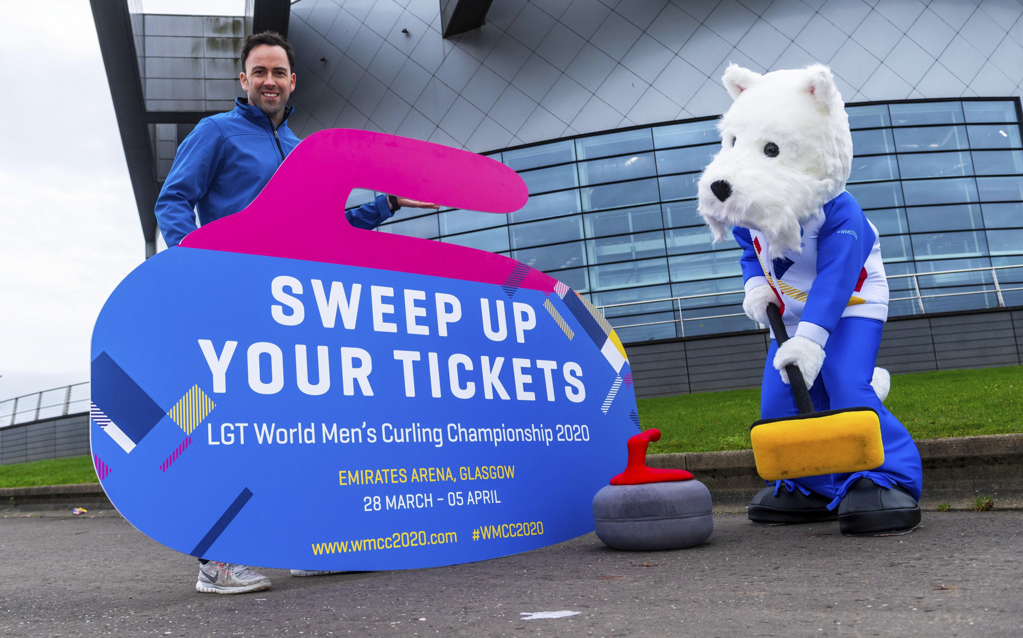 David Murdoch presenting the new mascot, Sweep, doing as the name suggests ©SNS