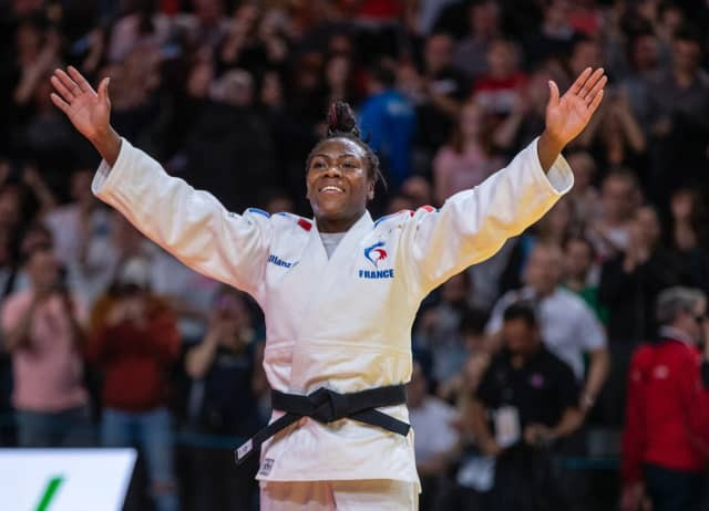 Clarisse Agbegnenou acknowledges the reaction of the 14,000 sell-out crowd after winning the women's under-63kg gold medal at the IJF Paris Grand Slam ©IJF
