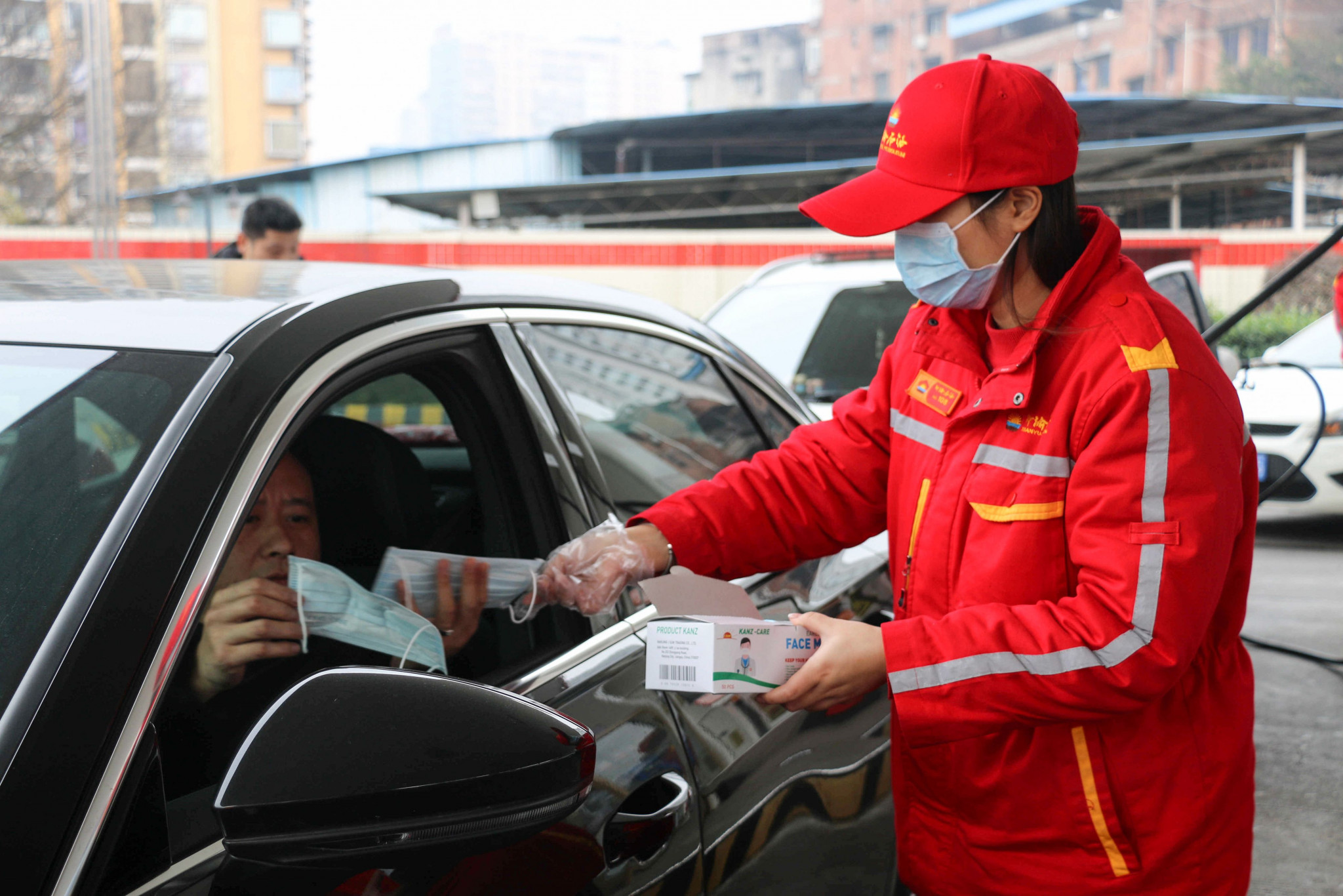 Protective masks are handed out in Chongqing, where an IFSC Worl Cup event will no longer take place in April ©Getty Images