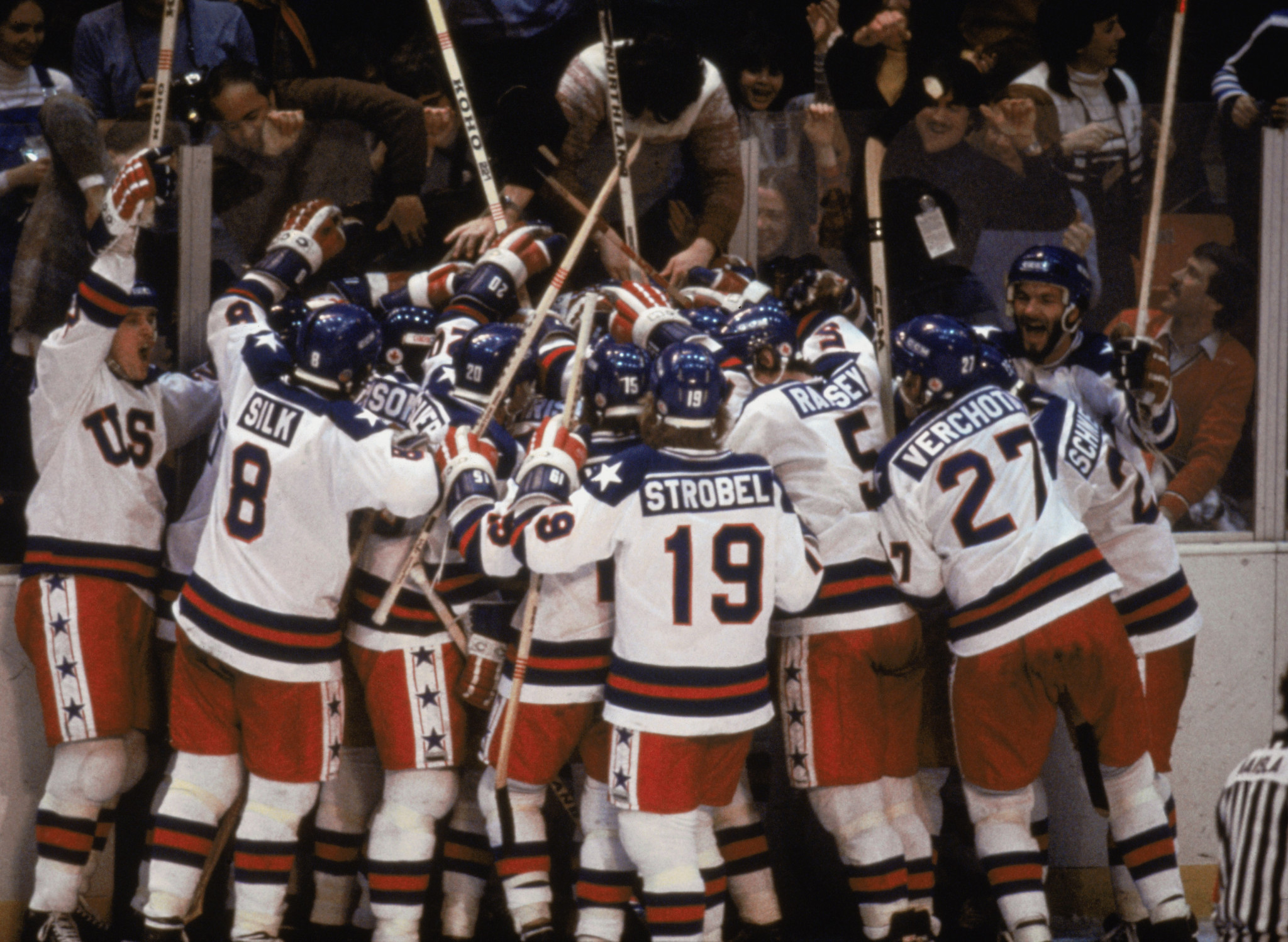 The United States ice hockey team collectively pinches itself after defeating the Soviet Union, five-times Olympic champions, at the Lake Placid 1980 Games, where they went on to take gold ©Getty Images