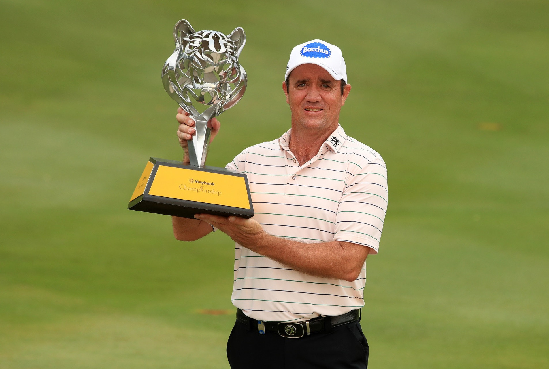 Scott Hend, pictured with the trophy, will not be able to defend the Maybank Championship this year as the event has been postponed due to the coronavirus outbreak ©Getty Images