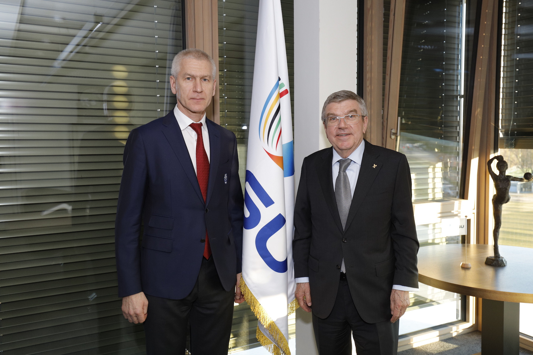 FISU welcome Bach to Lausanne headquarters for first time
