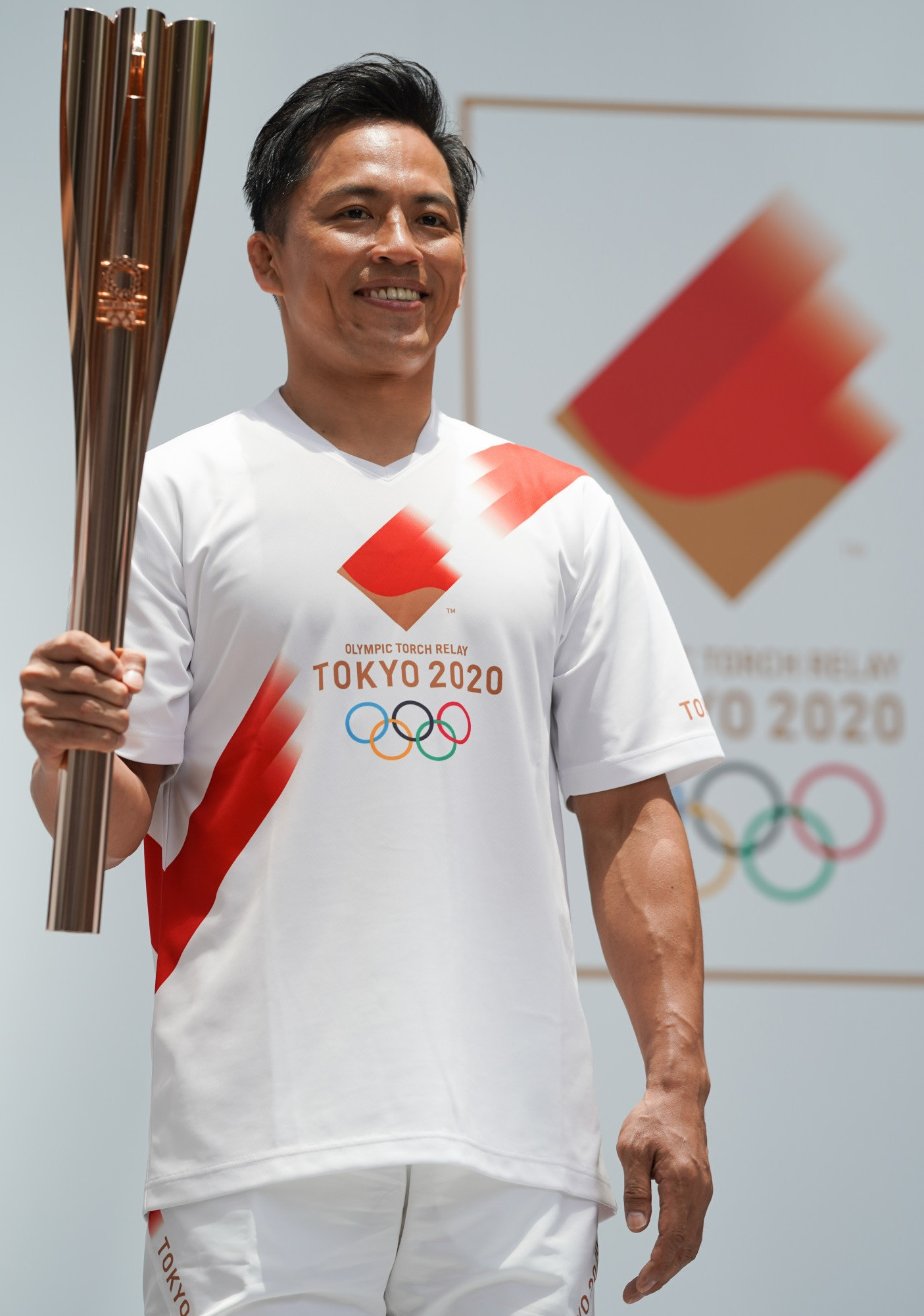 Judoka Tadahiro Nomura is playing his part in bringing the Olympic flame to Tokyo ©Getty Images