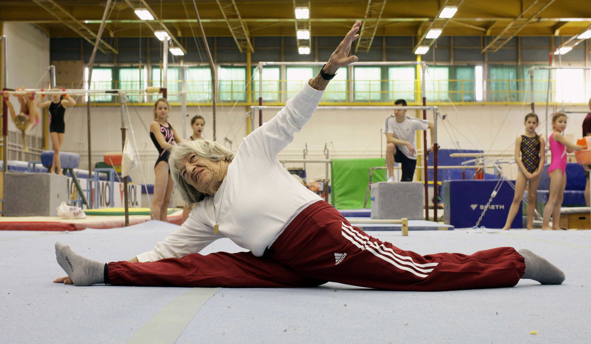 Former Hungarian gymnast Ágnes Keleti, pictured doing the splits at a Budapest gym in 2016, is the oldest living Olympic champion and celebrated her 99th birthday last month ©Getty Images