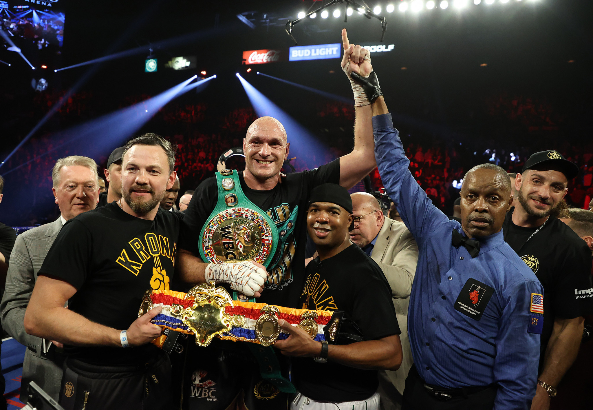 Tyson Fury holds his new belts along with his two Kronk Gym trainers, 'SugarHill' Steward and Andy Lee ©Getty Images