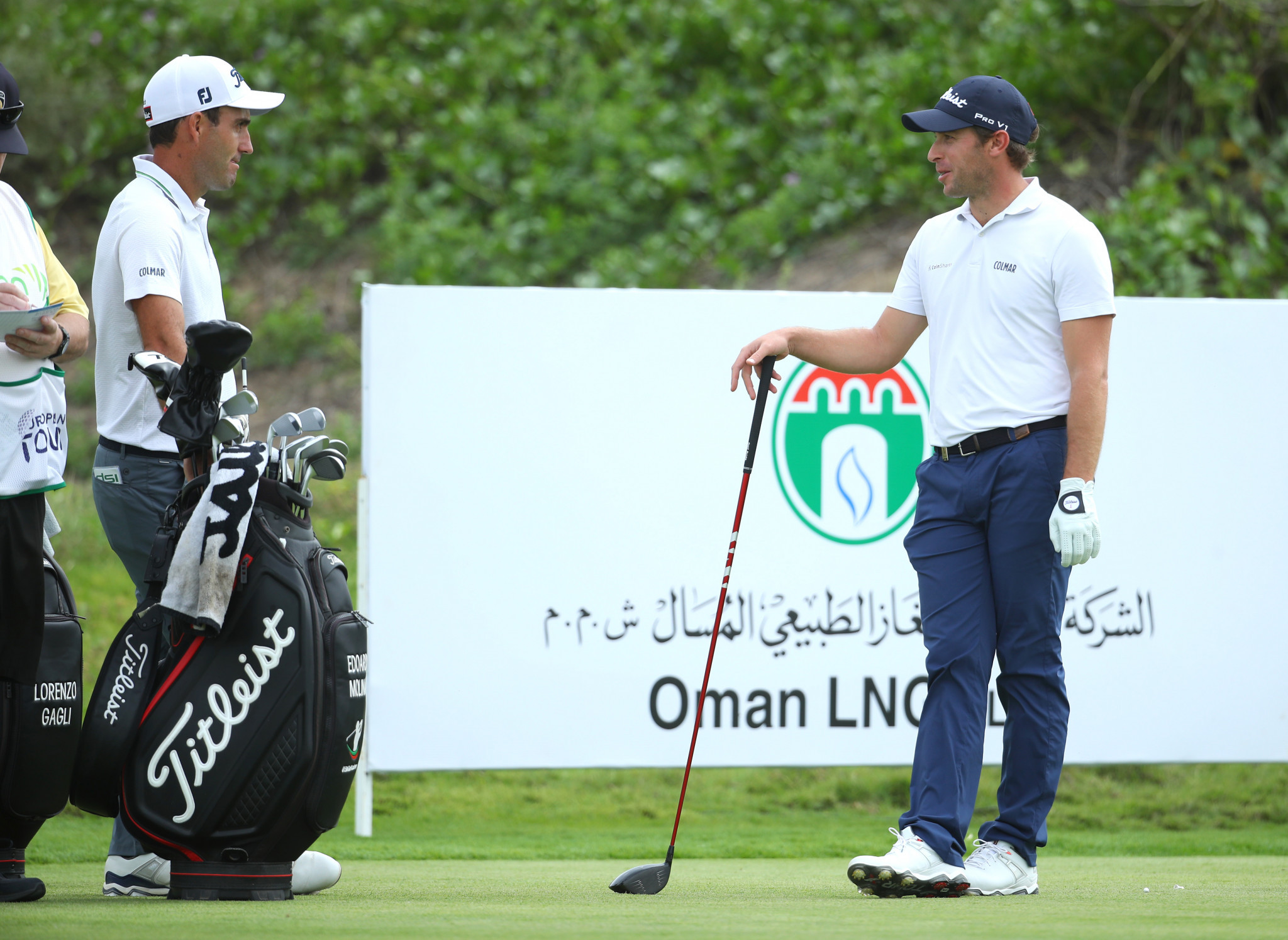 Edoardo Molinari, left, and Lorenzo Gagli chat at the Oman Open after being cleared to play ©Getty Images