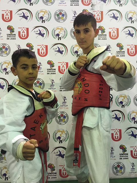 Brothers take Taekwondo Humanitarian Foundation black belt count to 11