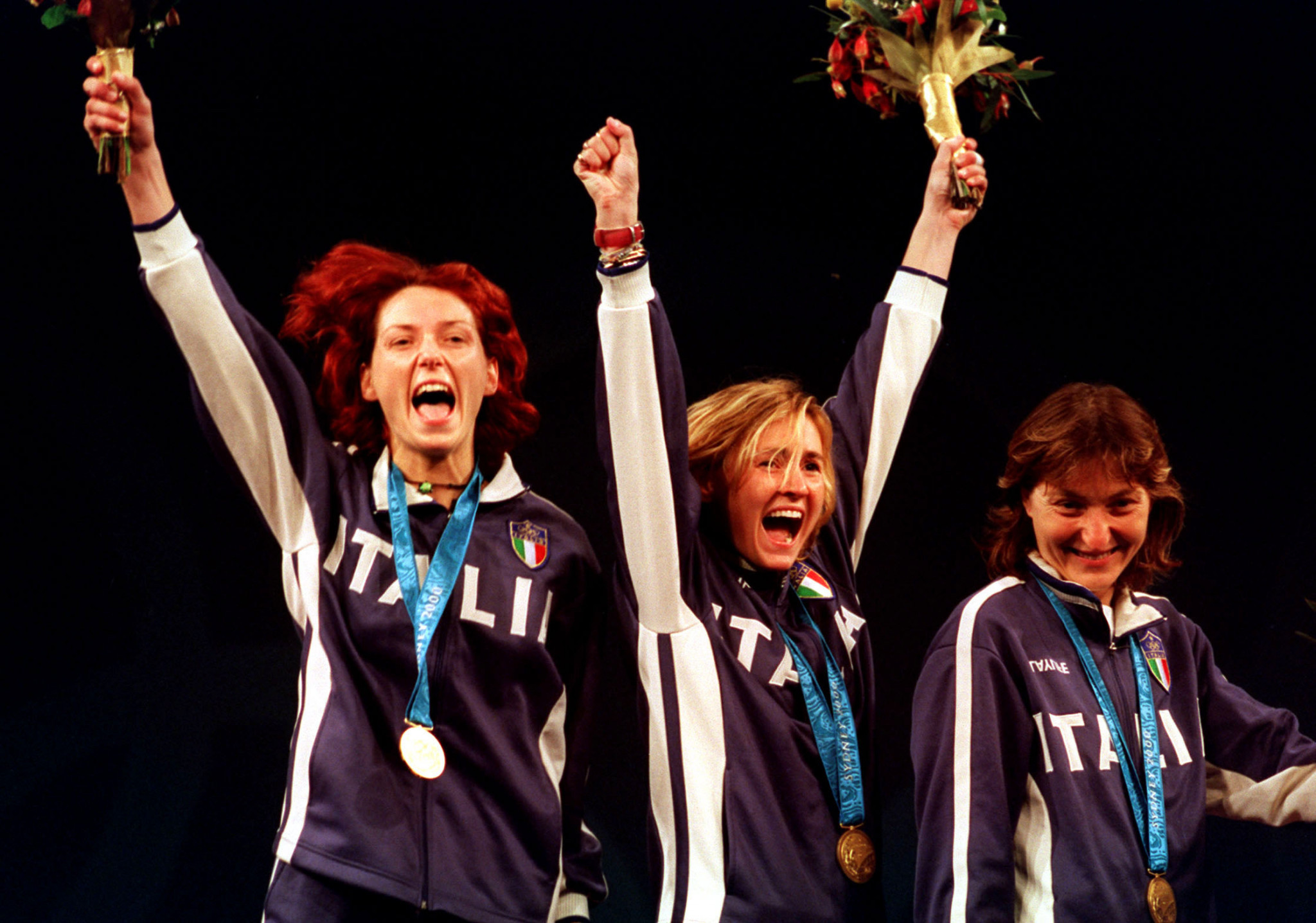 Diana Bianchedi, centre, won the second of her two Olympic women's team foil gold medals at Sydney 2000 ©Getty Images