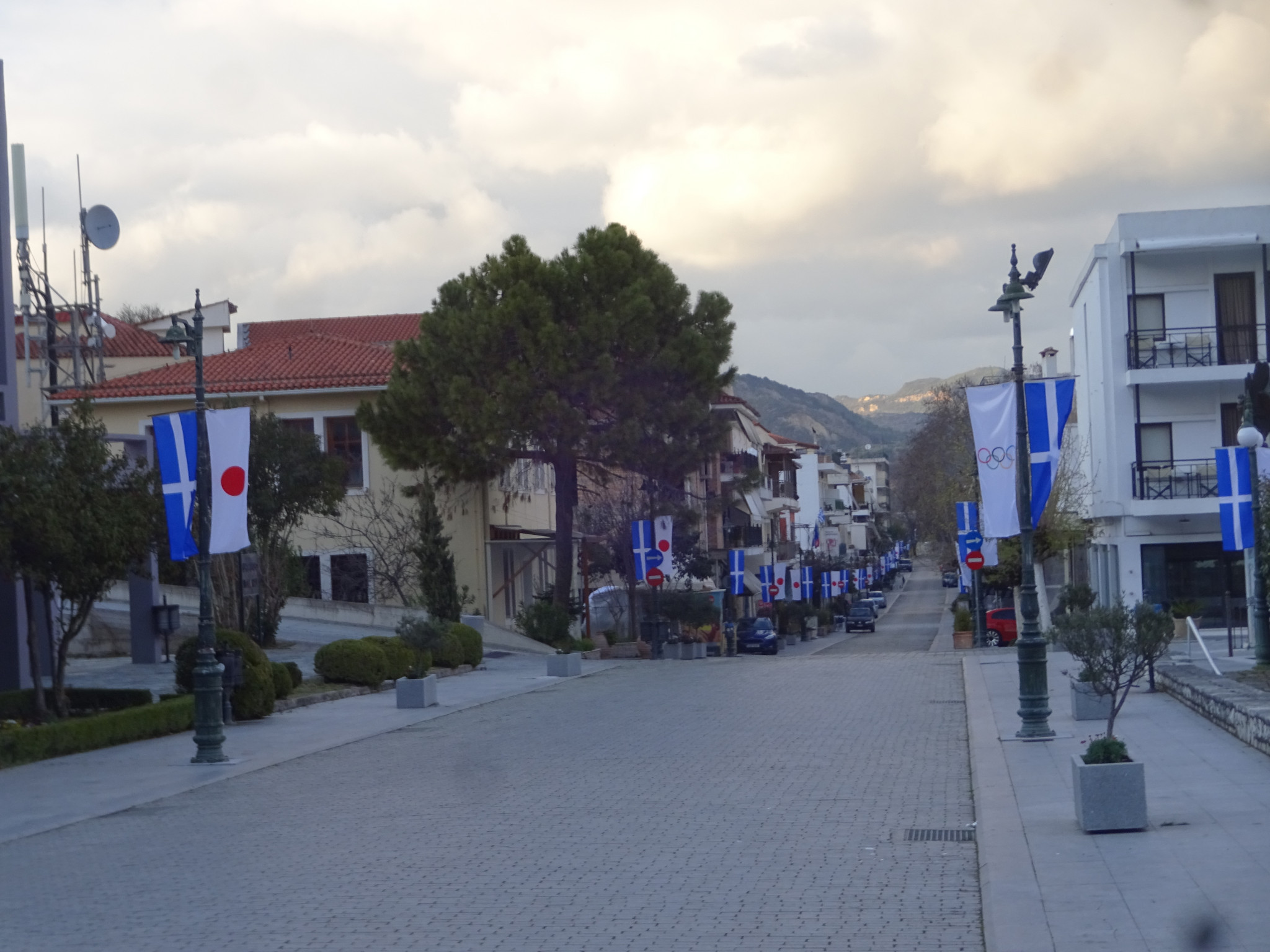 Greek and Japanese flags line the streets of an unusually deserted Olympia today as coronavirus hits planning for the lighting of the Olympic Flame for Tokyo 2020 on Thursday ©ITG