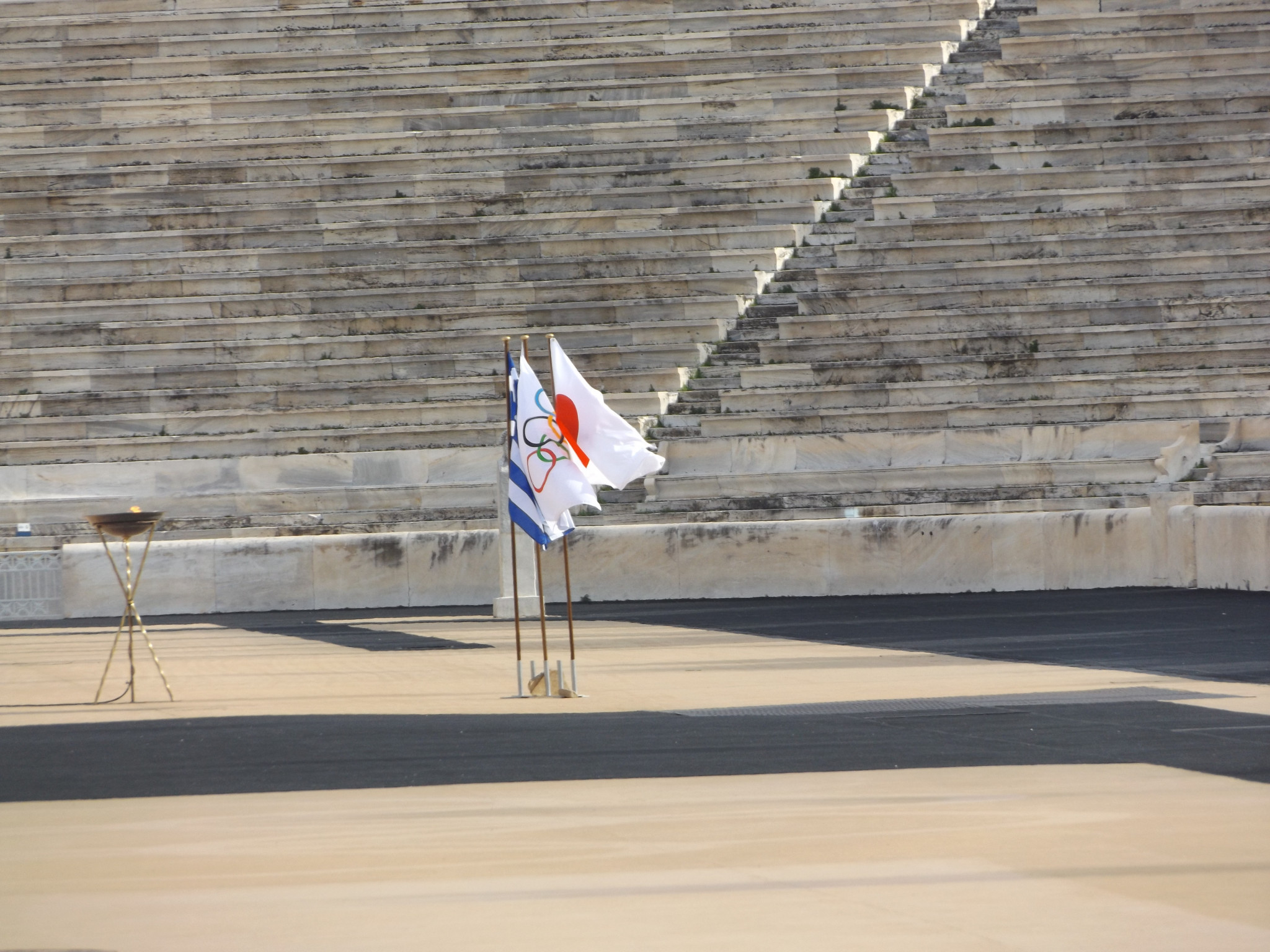 Greek, Japanese and Olympic flags at the Panathinaiko Stadium in Athens ©Philip Barker