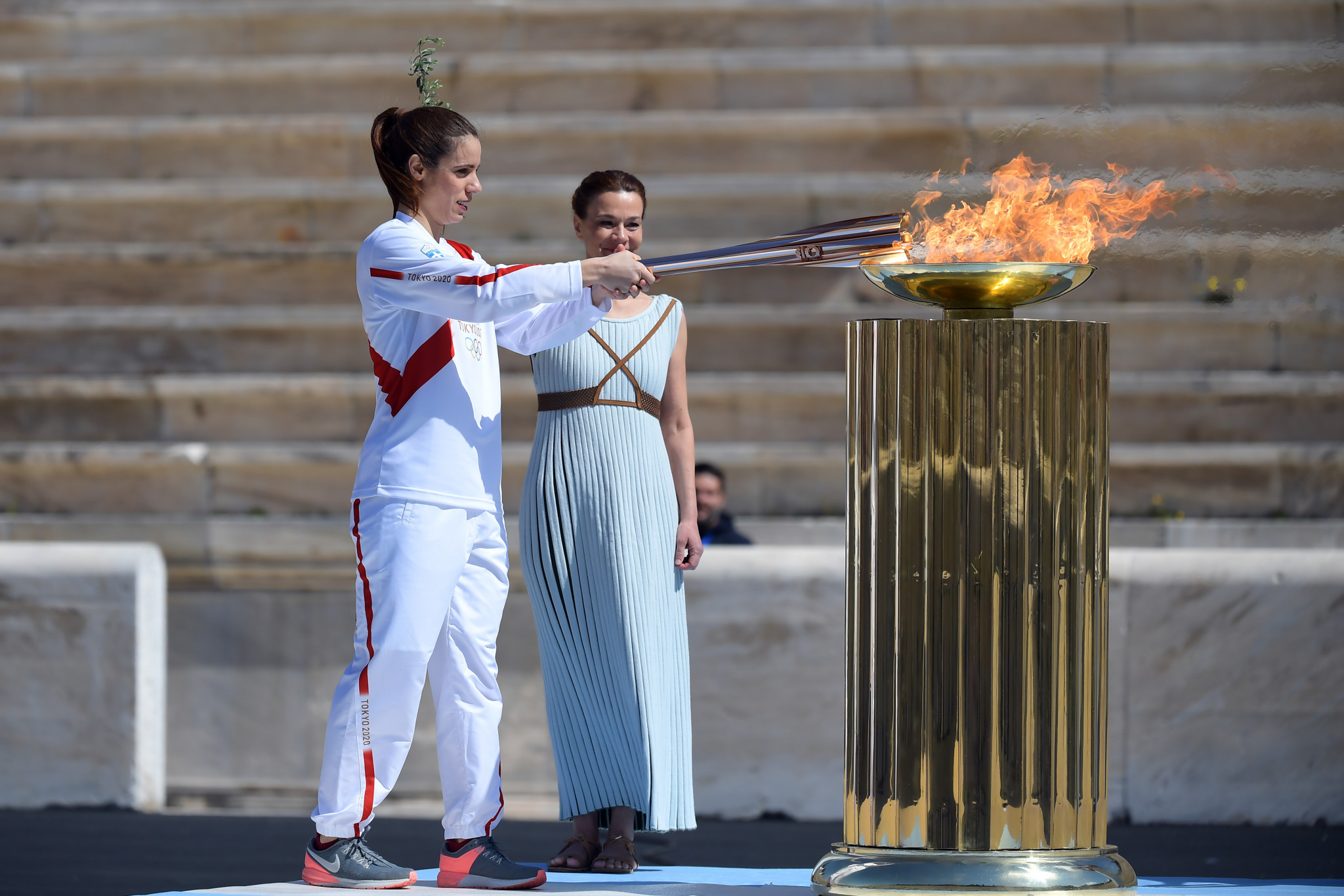 Greek pole vaulter Katerina Stefanidi lights a cauldron in the stadium ©Getty Images