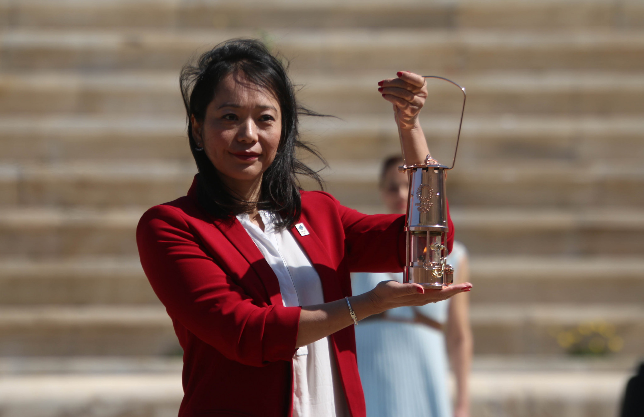 Swimming Olympian Naoko Imoto received the Olympic Flame on behalf of Tokyo 2020 in Athens ©Tokyo 2020