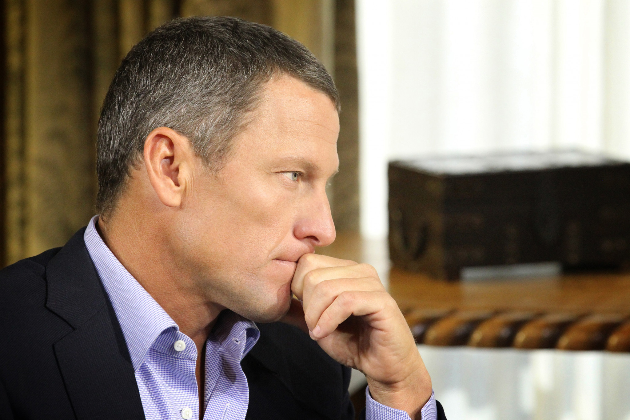 Disgraced cyclist Lance Armstrong admits doping may have caused testicular cancer