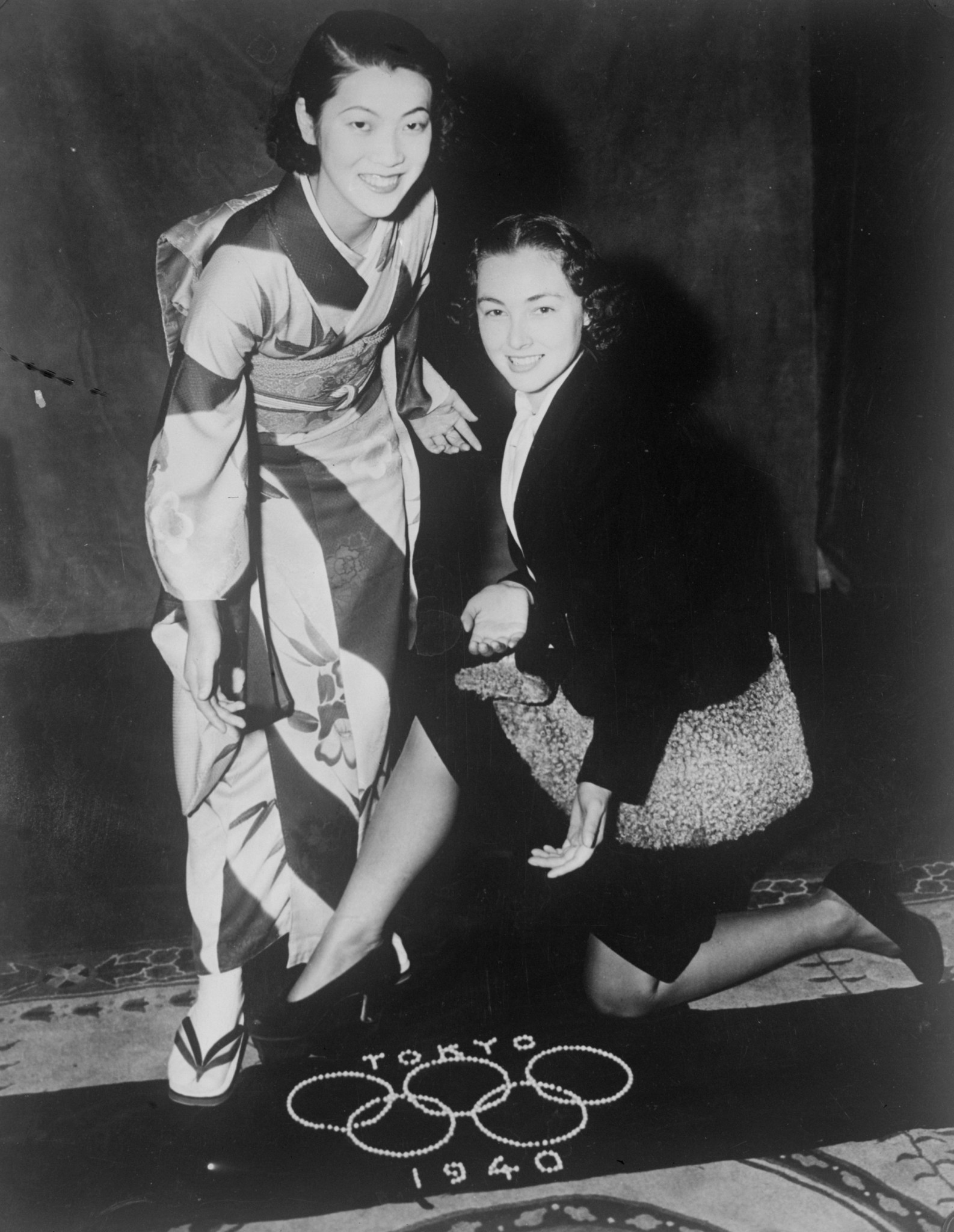 Two people pose with a banner for the the Tokyo 1940 Games which never took place ©Getty Images
