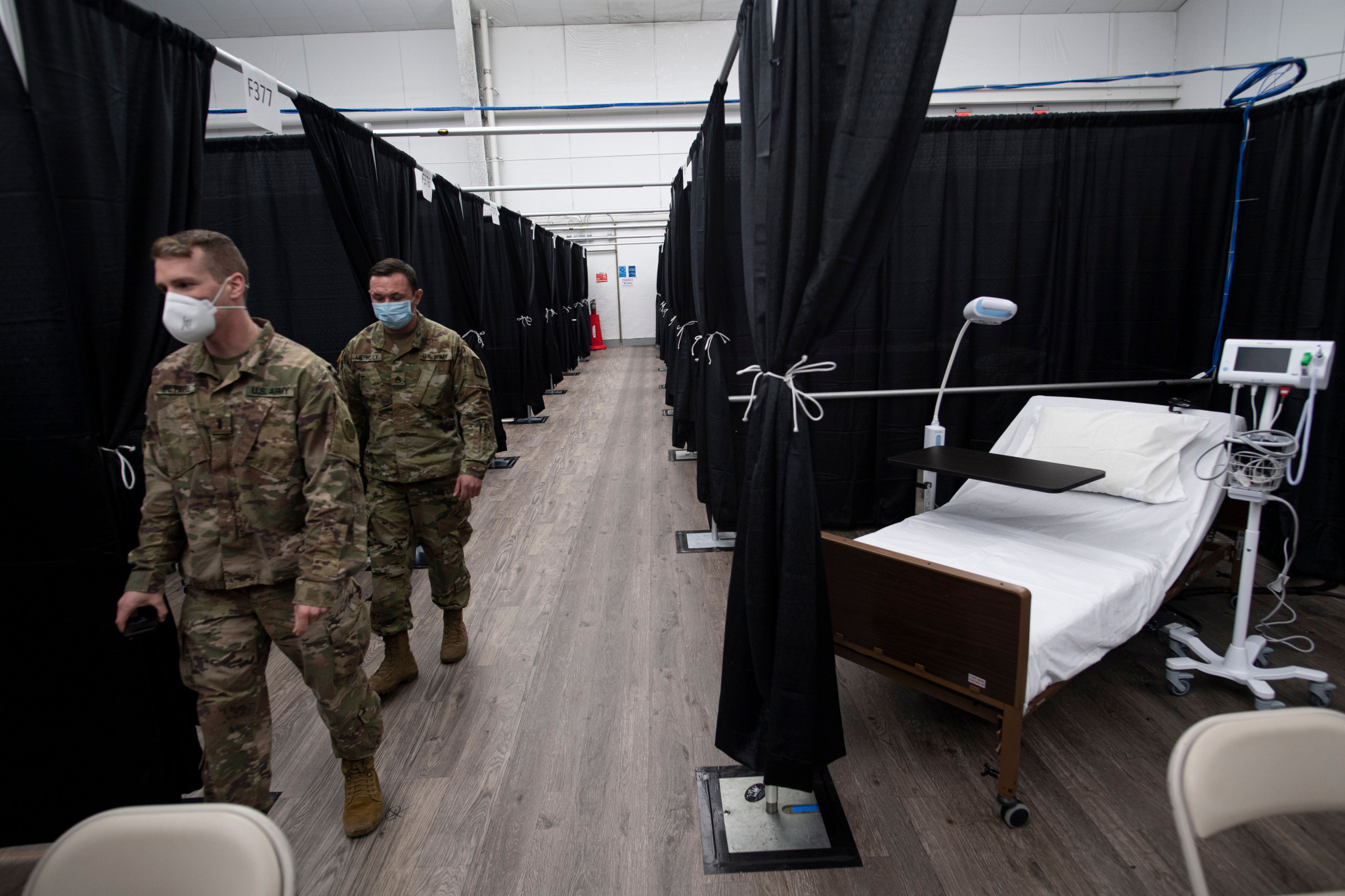 First patients arrive at makeshift hospital built in US Open tennis venue