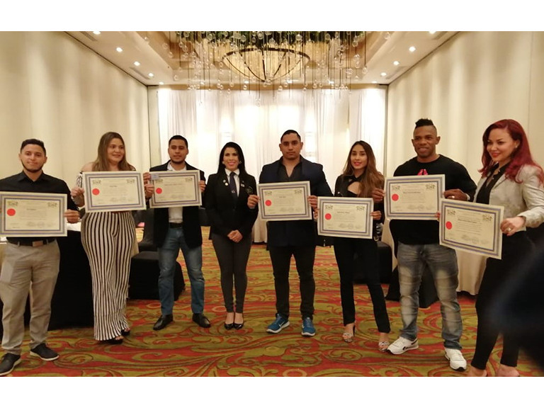 Personal trainers in Honduras receive certificates after completing IFBB course