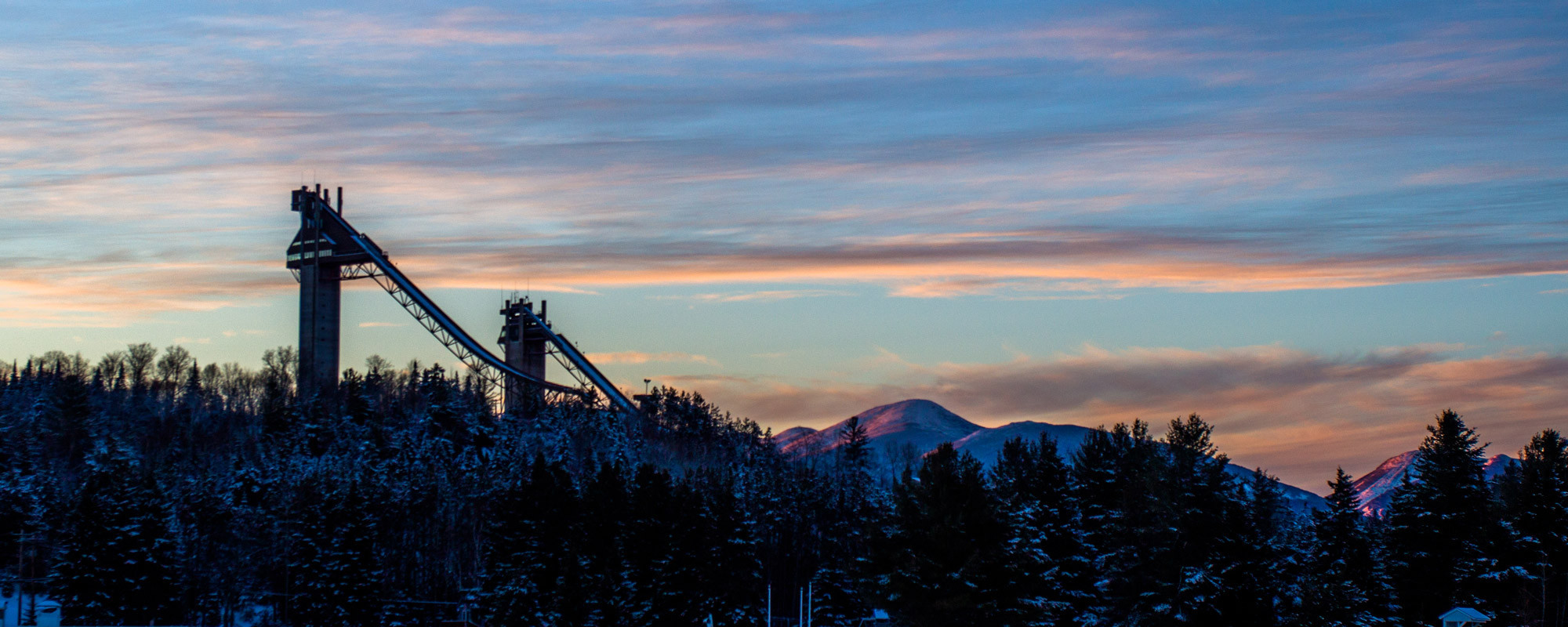 The historic ski jumps of Lake Placid will host the ski jumping competition at the 2023 FISU Winter World University Games ©FISU