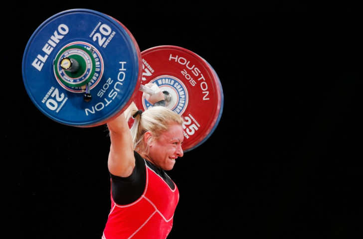 Azerbaijan's Boyanka Minkova Kostova breaks the women's 58 kilogram snatch world record with a lift of 112kg at the 2015 IWF World Weightlifting Championships