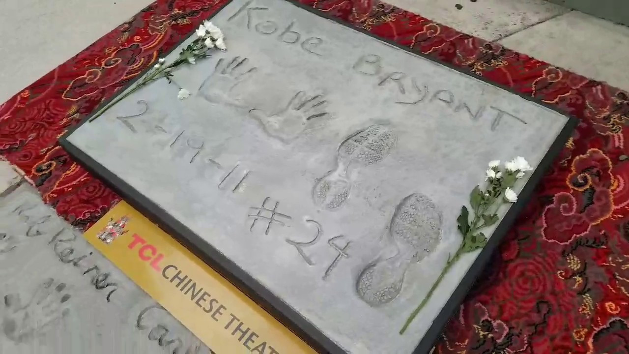 Bryant concrete handprints sell for $75,000 at auction
