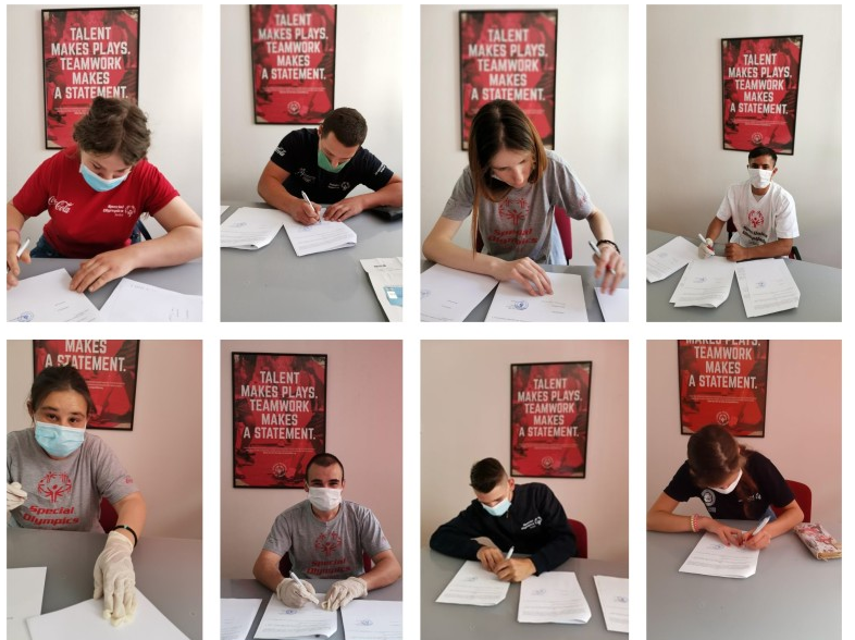 Eight of the 10 Special Olympics Serbia athletes signing their forms ©Special Olympics Serbia
