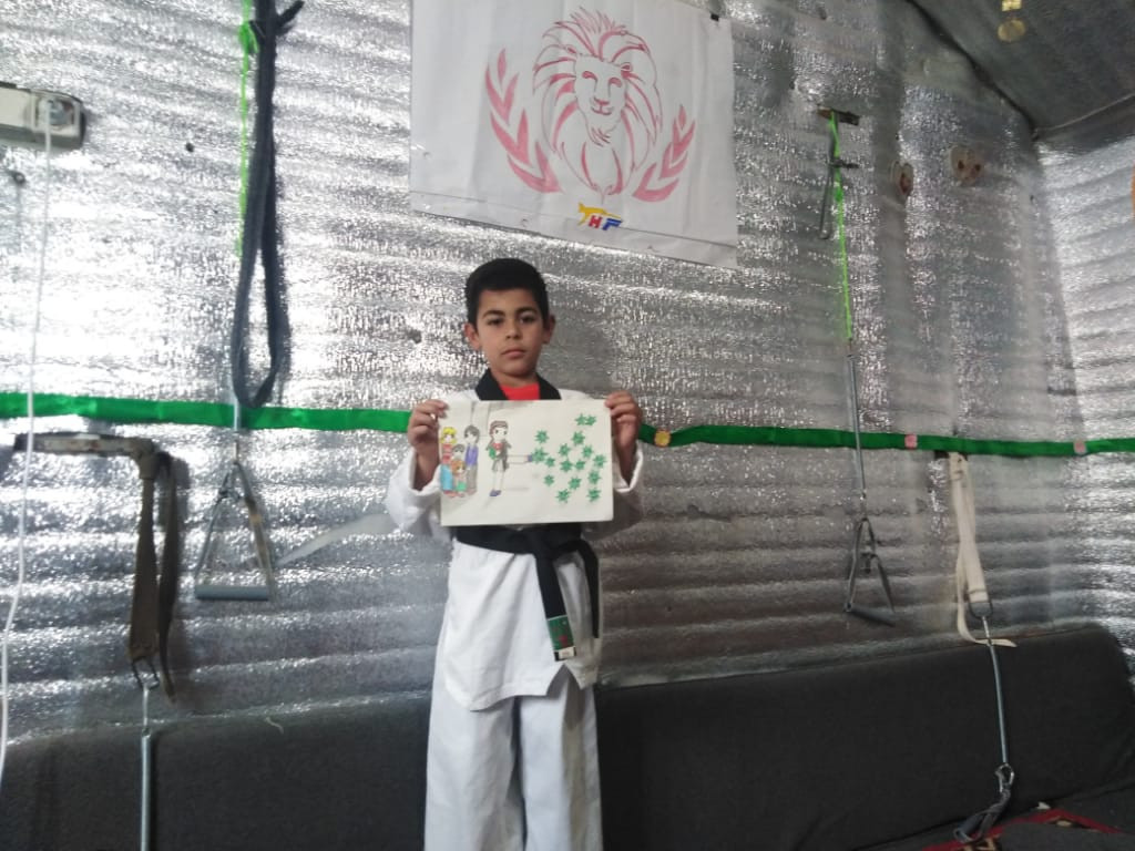 World Taekwondo President congratulates refugee for art contest success