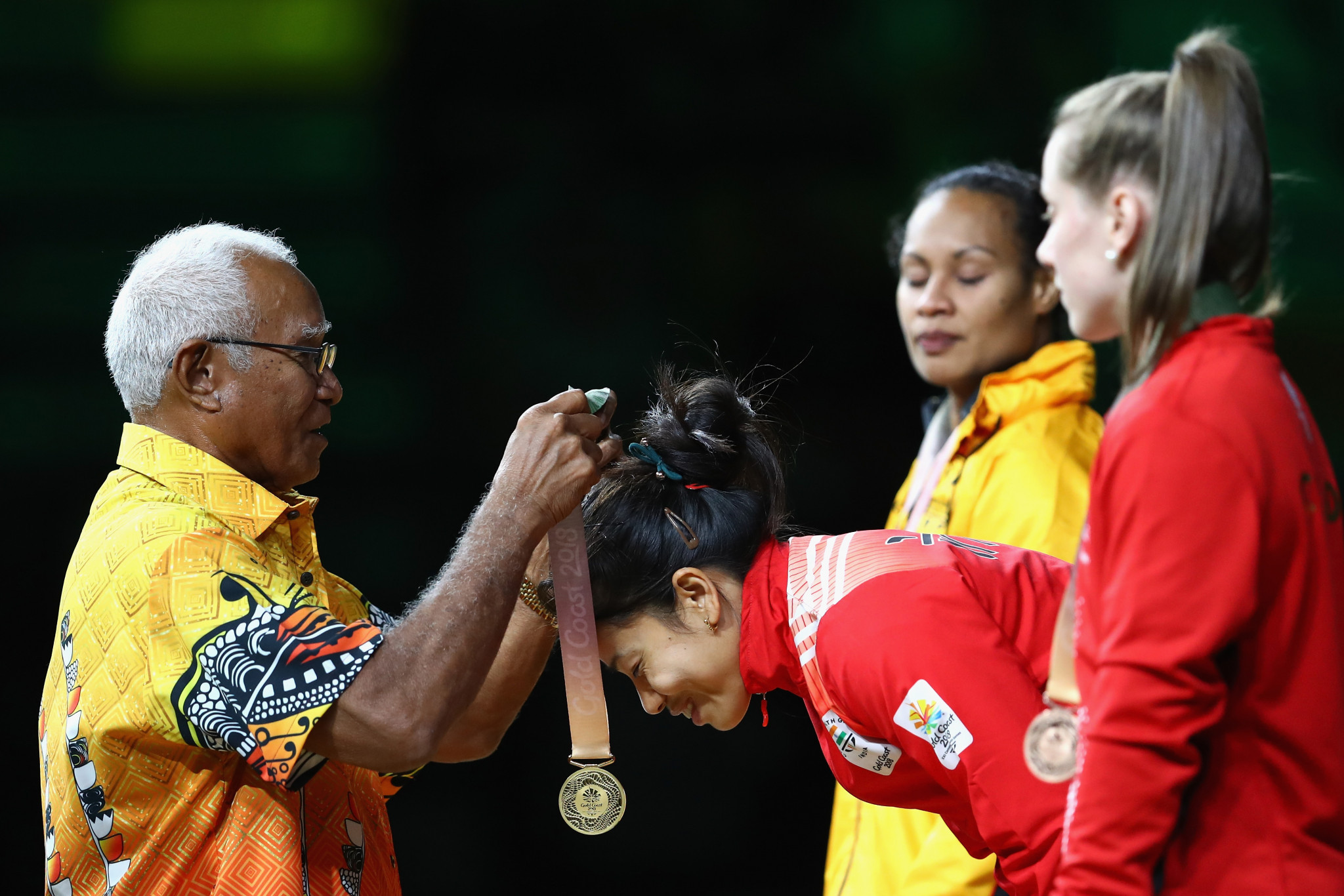 Sanjita Chanu Khumukcham receives a gold medal at gold Coast 2018 ©Getty Images