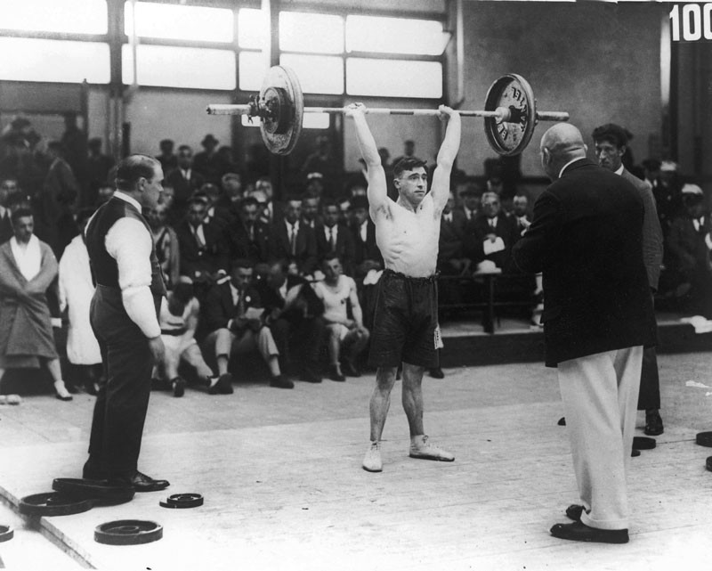Alf Baxter of Great Britain competes in a weightlifting event at the Amsterdam Olympics, 30th July 1928. © Central Press/Hulton Archive/Getty Images.