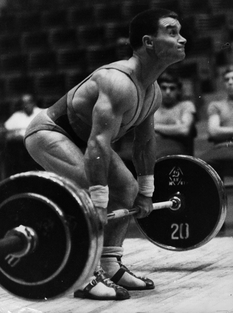 Hungarian weightlifter Imre Foldi in action at the 1968 Mexico Olympic Games. He set a new bantam weight world record of 367.5 kgs to win a silver medal. © Keystone/Getty Images.