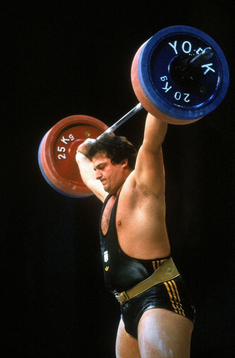 Dean Lukin of Australia on his way to winning gold in the Mens Weightlifting during the Olympic Games in Los Angeles, USA. © Getty Images.