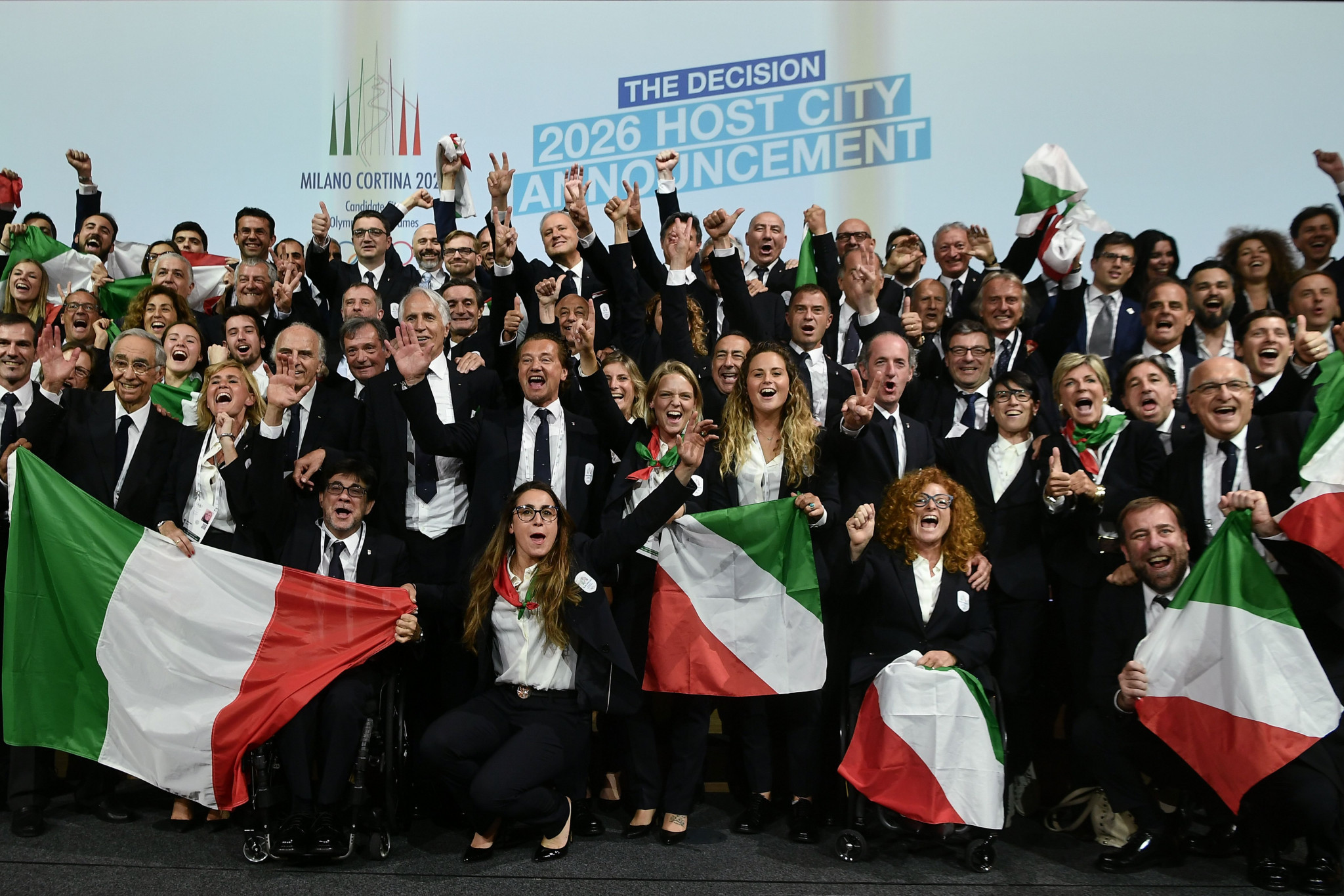 The Italian delegation celebrates winning the bid at last year's IOC Session in Lausanne ©Getty Images