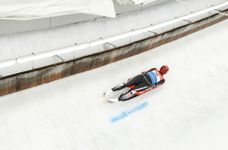 Germany's Felix Loch won the men's sprint event to edge up to third place in the Luge World Cup rankings
