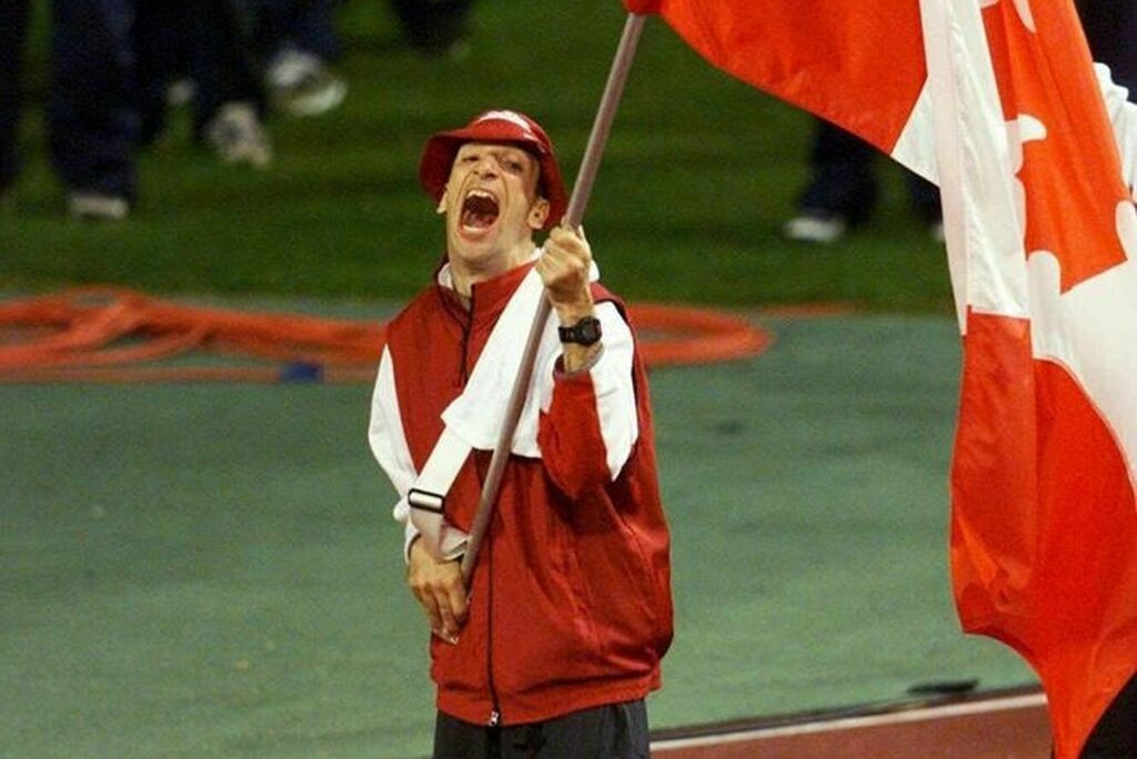 Canada's Sydney 2000 Paralympic flag-bearer Longhi dies at 56