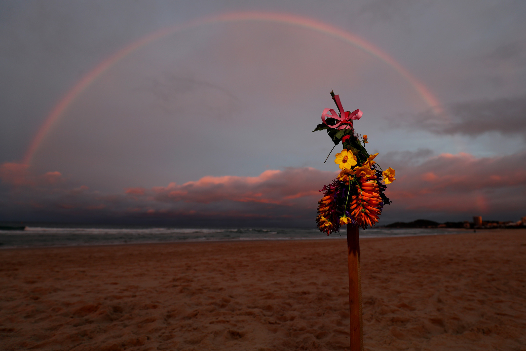 Tributes have already been placed on the beach where Alex Pullin was found ©Getty Images