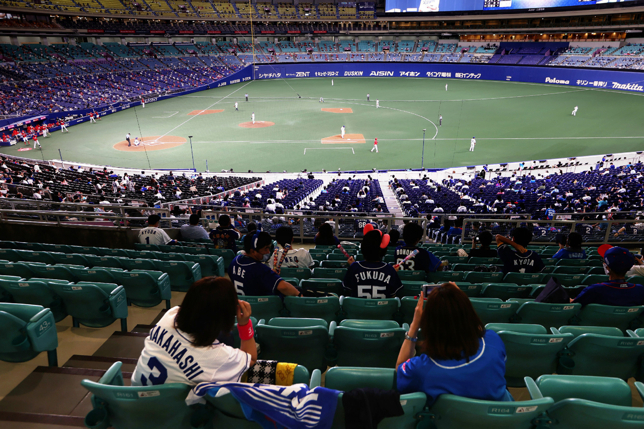 Fans return to stadiums in Japan under precautions as coronavirus cases rise