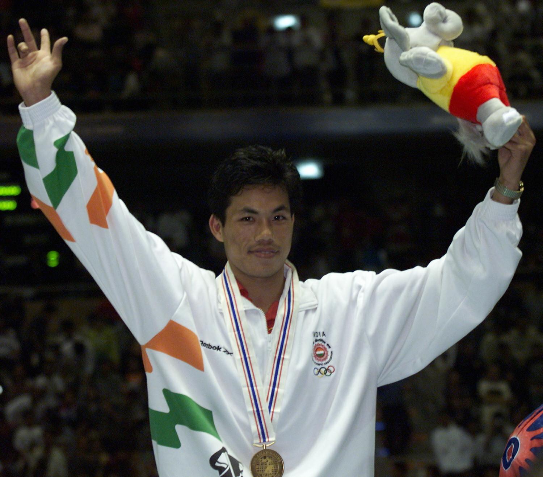 Asian Games boxing champion beats COVID-19 while battling cancer